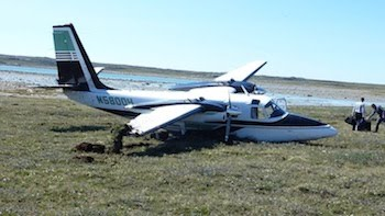 Aero Commander lands short of runway